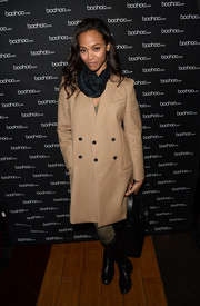 Zoe Saldana attended the boohoo.com event all covered up in a beige wool coat.