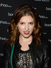 Anna Kendrick's bright red lipstick was a shock of color against her pale skin.