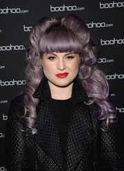 Kelly Osbourne was elaborately coiffed with these towering victory rolls at the boohoo.com event.