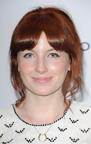 Alice Levine attended the Very.co.uk launch party sporting a soft, loose updo with center-parted bangs.