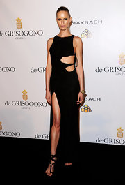 Karolina Kurkova sizzled at the de Grisogono party in black leather T-bar sandals, which wrapped around her ankles.