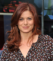 Debra Messing wore her  gorgeous red hair in shiny waves at the The Give-A-Toy Store opening in NYC.