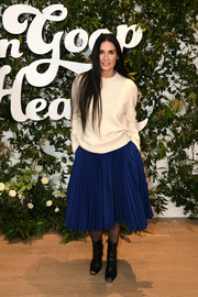 Demi Moore gave her sweater an ultra-feminine finish with a pleated cobalt skirt.