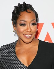 Tichina Arnold went for vintage glamour with this finger wave at the iHeartRadio album release party.