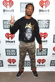 Josh Baze opted for a casual and cool look with these camo print pants.