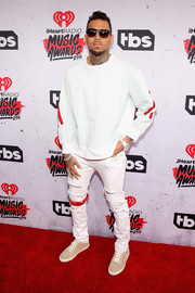 A pair of white distressed jeans completed Chris Brown's look at the iHeartRadio awards.