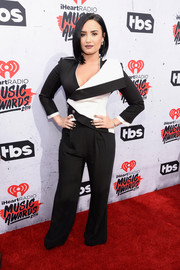 Demi Lovato was all business in a black-and-white pantsuit by Alexander McQueen at the iHeartRadio Music Awards.