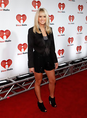 Carrie Underwood opted for a rocker chic look at the iHeartRadio music festival in Las Vegas. The country star wore sparkly shorts paired with a black blazer. Black booties with a glittered heel and fan detailing finished off the look.