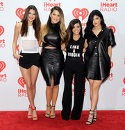Kourtney Kardashian rocked a '70s vibe in black wide-leg pants and a tank top at the iHeartRadio Music Festival.