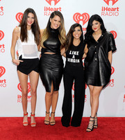 Kourtney Kardashian kept it casual in a 'Like a Virgin' tank top when she attended the iHeartRadio Music Festival.