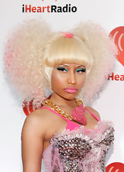 Nicki Minaj wore platinum blond pigtails with pink tips at the iHeartRadio music festival.