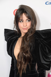 Camila Cabello wore her long hair down in a wavy style during iHeartRadio's Z100 Jingle Ball 2019.