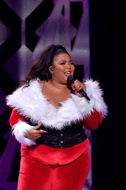 Lizzo teamed a broad black belt with a Santa Claus-inspired catsuit for iHeartRadio's Z100 Jingle Ball 2019.