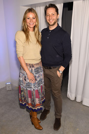 Gwyneth Paltrow paired a patchwork print skirt with a beige sweater for the In goop Health Summit.