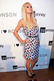 Paris Hilton balanced her flirty I Hear Ronson frock with burgundy patent platform pumps.