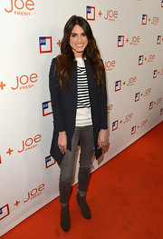 Nikki Reed kept her look preppy cool in a white and navy panel sweater.