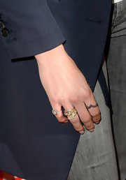 Nikki Reed blinged it up with a chunky gold ring with diamond insets.