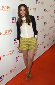 Louise Roe added some color to her casual look with these yellow and tan print shorts.