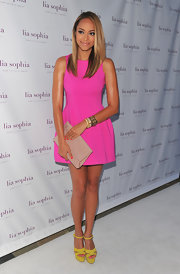 Amber Stevens got colorful for the Lia Sophia launch in a full bubblegum pink dress and canary yellow platform sandals.