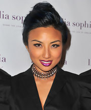 Jeannie Mai stuck to a classic hairstyle with this soft, loose bun when she attended the unveiling of lia sophia's latest jewelry creations.