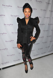 Jeannie Mai teetered on super-high black platform pumps when she attended the unveiling of lia sophia's latest jewelry creations.