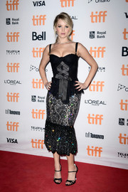 Jennifer Lawrence got dolled up in a Swarovski crystal-embellished peplum dress by Dolce & Gabbana for the TIFF premiere of 'mother!'