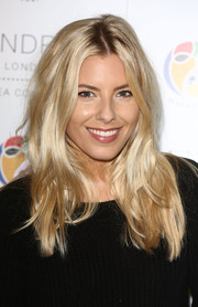 Mollie King sported casual center-parted tresses during the mothers2mothers World AIDS Day VIP lunch.