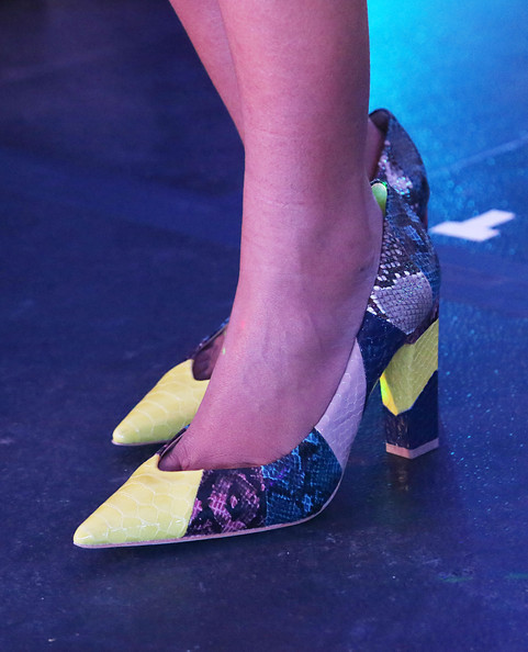 Solange is not one to shy away from bold patterns as she demonstrated with these colorful snakeskin pumps.