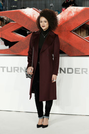 Nathalie Emmanuel teamed a burgundy coat with a black turtleneck and jeans for the European premiere of 'xXx: Return of Xander Cage.'