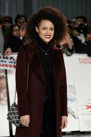 Nathalie Emmanuel accessorized with a chic diamond-patterned chain-strap bag by Louis Vuitton at the European premiere of 'xXx: Return of Xander Cage.'