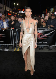 Ruby Rose went for sultry glamour at the LA premiere of 'xXx: Return of Xander Cage' in a gold sequin dress by Julien Macdonald boasting a down-to-the-navel neckline and a thigh-high slit.