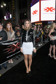 Maria Menounos attended the LA premiere of 'xXx: Return of Xander Cage' wearing a cropped leather jacket over a little white dress.