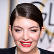 Lorde's Sleek Ponytail and Crisp Red Lips