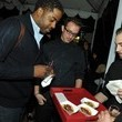 Guests check out the veggie fare at the Stella McCartney LA Holiday Party
