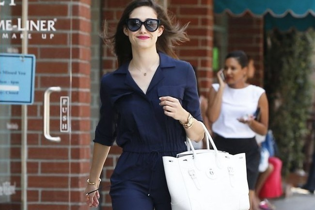 Emmy Rossum wearing a navy jumpsuit