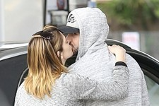 Ashley Greene Gets a Christmas Kiss