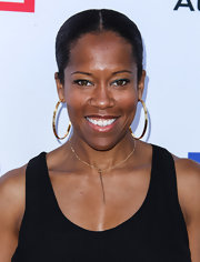 Regina King spruced up her casual outfit with a pair of huge gold hoops at the Children Mending Hearts Style Sunday.