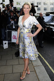 Denise van Outen channeled vintage as she wore a satin print dress at the 2010 Glamour Awards.