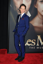 Eddie Redmayne looked cool in blue at the 'Les Mis' premiere in NYC where he wore this crisp blue suit with red tie and red pocket square.