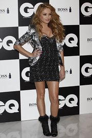 Paulina Rubio shined in a strapless metallic dress under her silver lame' blazer at the GQ photocall.