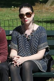 Michelle Trachtenberg paired a glitzy gemstone statement necklace with her heavily embellished top.