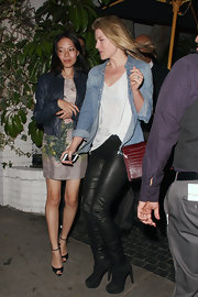 Ali Larter paired her white tee and denim shirt with leather pants for a cool and casual evening look.