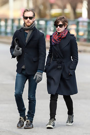 Anne Hathaway chose a purple and red, patterned scarf to add just a dash of color to her daytime look.