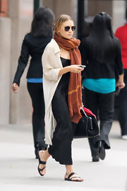 Ashley Olsen was on the go in New York City wearing a casual pair of black backless flat sandals.