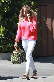 Ashley Tisdale's bright pink sweater gave her a summery look when paired with white skinny jeans.