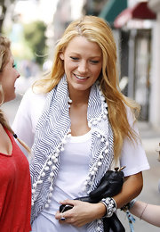 Blake Lively rocked the set of 'Gossip Girl' in New York with a casual summer outfit, complete with a white and blue striped scarf and an embellished bangle by Matthew Campbell Laurenza.