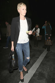 Charlize Theron dressed up a pair of rugged jeans with this sleek black blazer.
