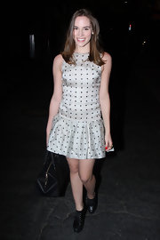 Christa B. Allen chose a silver, polka dot dress with a frill skirt for her look while out in Hollywood.