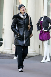 Claire bundled wile in Soho in a luxury printed scarf.