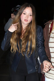 Devon Aoki chose a navy blue leather jacket for her fun and funky evening look.